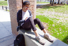 Student sitting on a wall