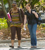 Two students walking through campus