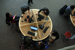 Photo of students at computer workstations