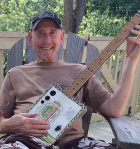 Steve Boyer, with his cigarbox guitar