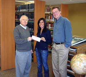PHOTO: Talita Thomaz receives her scholarship check
