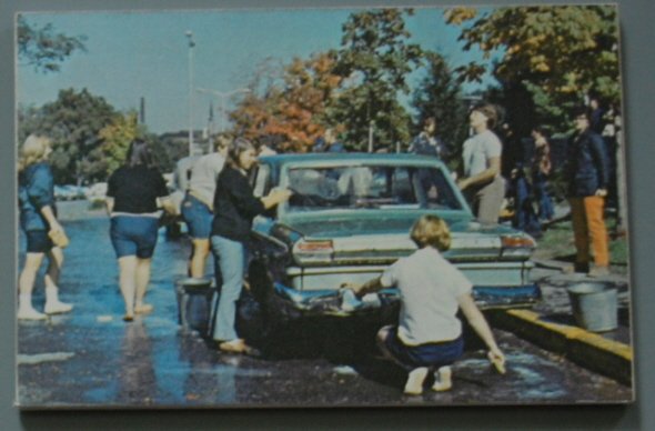 Students washing a car