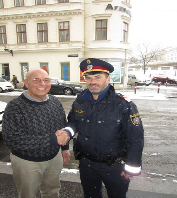 Prof Jurain greets policeman Vienna 2013